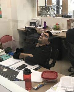 Lab member sleeping at his desk